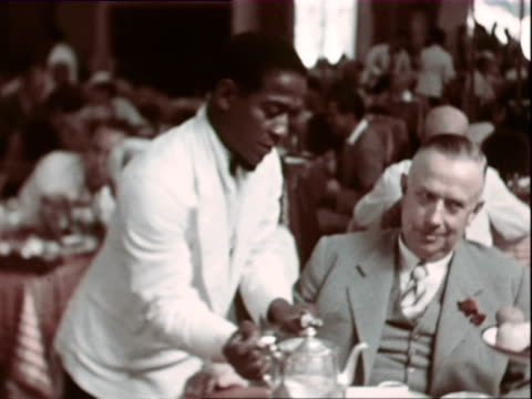 vidéos et rushes de october 1936 montage waiter pouring tea to gentleman in restaurant / west indies - antilles occidentales