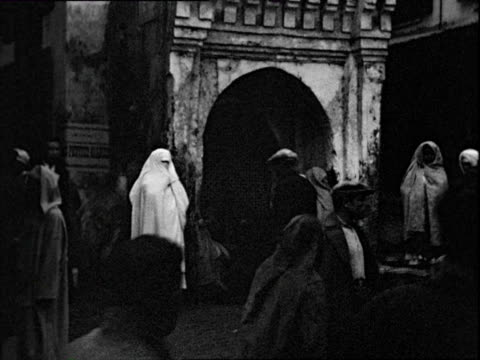 October 1938 B/W MONTAGE Street scenes, women in veils and burkhas, vendors, picture seller / Tangier, Morocco