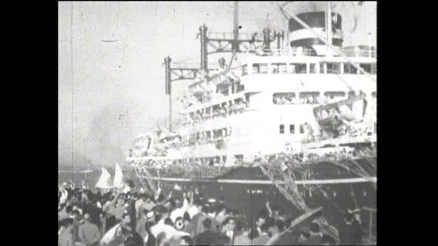 october 2 emigrants boarding cargopassenger ship named america maru for brazil many people casting farewell paper tapes and sending someone off from... - emigration and immigration点の映像素材/bロール