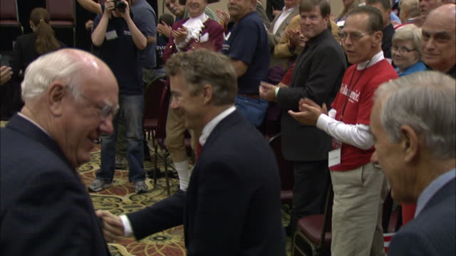 October 2 2010 TS Rand Paul and his father Ron Paul greeting rally attendees in the Holiday Inn ballroom / Erlanger Kentucky United States