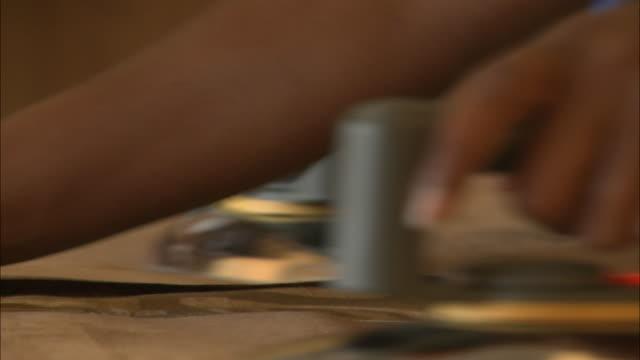 october 20 2010 tu hands ironing brown cloth / mozambique - bordsyteinspelning bildbanksvideor och videomaterial från bakom kulisserna