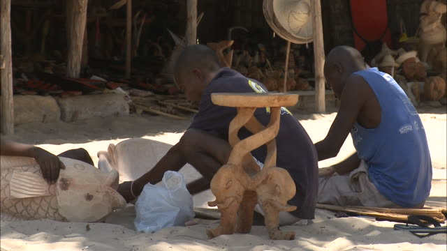 october 20, 2010 sculptors sanding and creating pieces / mozambique - stationary process plate stock videos & royalty-free footage