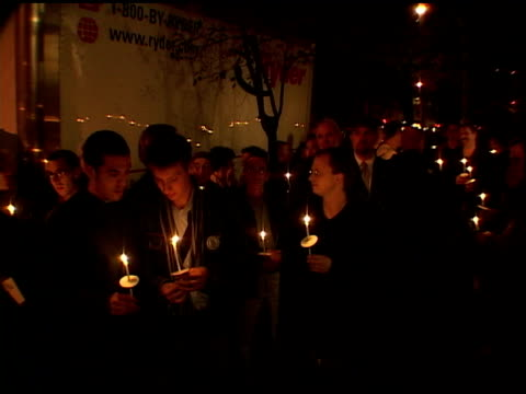 october 2001-- vs candlelight vigil, single candle burning w/ crowd in bg - 2001 stock videos & royalty-free footage