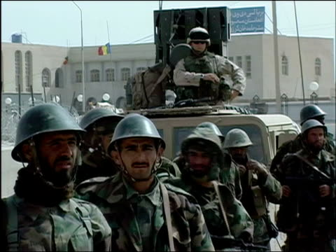 October 2004 Afghan National Army troops lined up for count outside Romanian military compound for USled joint patrol with Romanian Embedded Training...