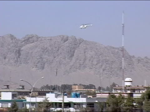 October 2004 UN helicopter transporting ballots to Kandahar Stadium for vote count in days immediately following presidential election / Kandahar...