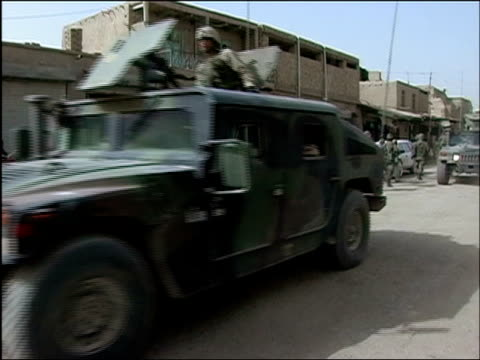 vídeos de stock, filmes e b-roll de october 2004 us humvees driving past afghan national army troops on joint patrol with romanian embedded training team in days leading up to first... - civil