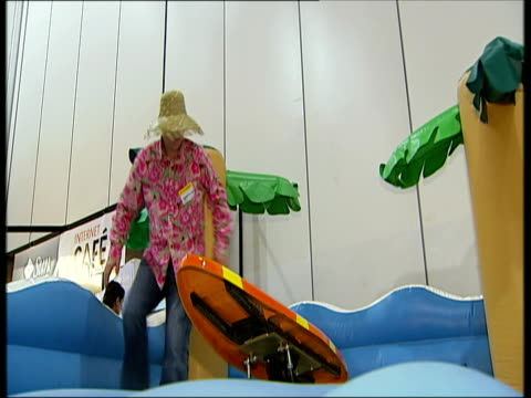 october 2008 montage men trying out a surfing board simulator at games exhibition/ london uk/ audio - 1 minute or greater stock videos & royalty-free footage