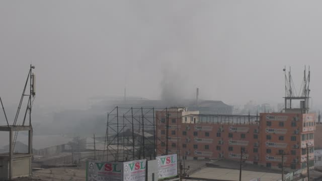 smoke from rerolling factory smokestack at shampur in dhaka - condensation stock videos & royalty-free footage