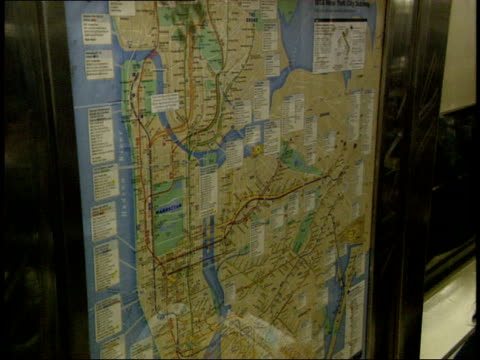 october 21, 2004 a map and passengers on a new york city subway train / new york, united states - bahnreisender stock-videos und b-roll-filmmaterial