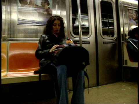 october 21, 2004 montage passengers riding on a new york city subway train / new york, united states - 2004 stock videos & royalty-free footage