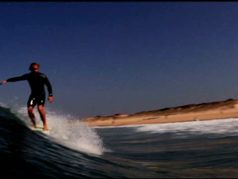 stockvideo's en b-roll-footage met october 21, 2009 montage long board surfers catching and riding mellow waves - letterbox format