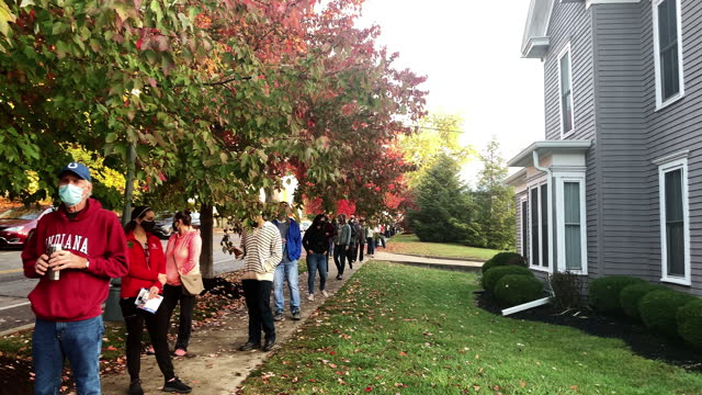 october 22, 2020; bloomington, indiana: voters wait in line to vote early in the 2020 united states presidential election. voters stretched for... - united states presidential election stock videos & royalty-free footage