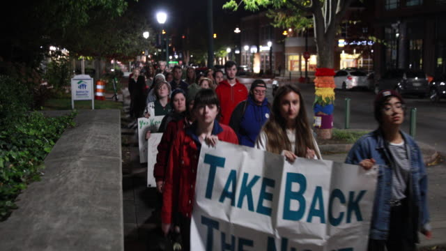 "october 25, 2018; bloomington, indiana: indiana university students, and others participate in a, ""take back the night,"" march and rally from indiana... - sexual violence stock videos & royalty-free footage"