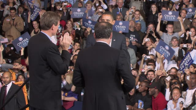 October 28 2008 Democratic presidential candidate Barack Obama embracing Virginia senator Mark Warner and Virginia governor Tim Kaine at campaign...