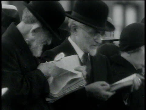 october 3, 1932 montage jews reading and praying outside synagogue and on dock / new york, new york, united states - judaism stock videos & royalty-free footage