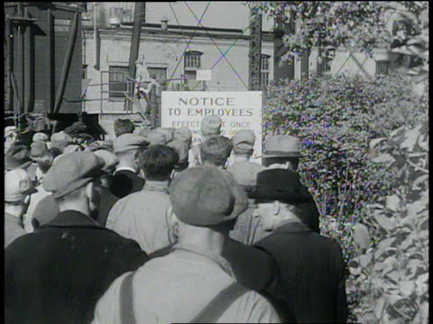october 3, 1932 montage workers gathering outside factory / united states - 1932 stock videos & royalty-free footage
