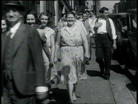 october 3, 1932 montage workers walking along sidewalk and sewing in factory / united states - 1932 stock videos & royalty-free footage