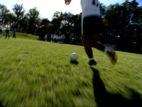 october 3 2003 ts girl kicking a soccer ball during practice at stone ridge high school in bethesda / maryland united states - bethesda maryland stock videos & royalty-free footage
