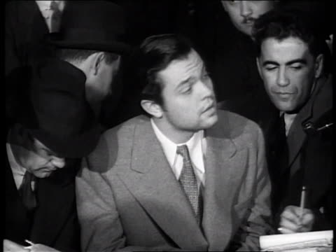 stockvideo's en b-roll-footage met october 31 1938 ha orson welles press conference regarding war of the worlds controversy / new york city new york united states - 1938