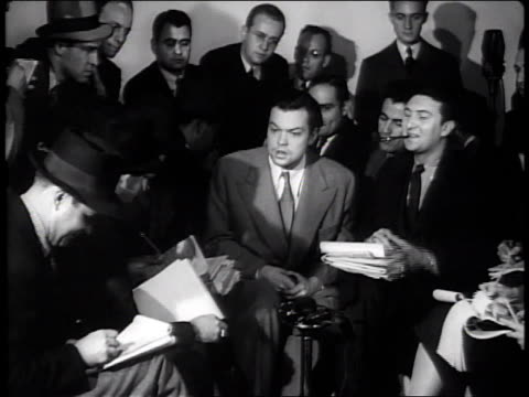 stockvideo's en b-roll-footage met october 31 1938 ws orson welles press conference regarding war of the worlds controversy / new york city new york united states - 1938