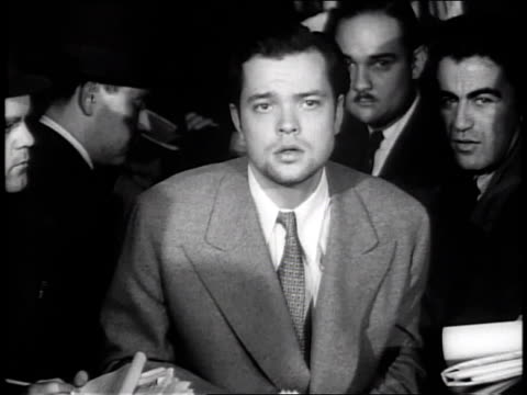 stockvideo's en b-roll-footage met october 31 1938 ms orson welles press conference regarding war of the worlds controversy / new york city new york united states - 1938