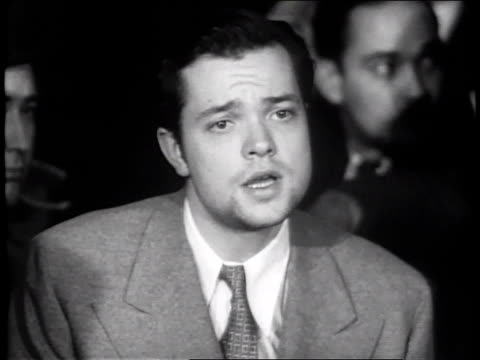 stockvideo's en b-roll-footage met october 31 1938 cu orson welles press conference regarding war of the worlds controversy / new york city new york united states - 1938