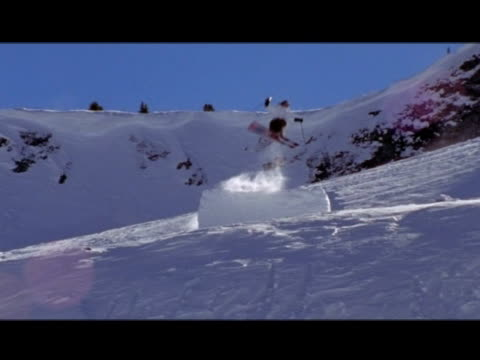 vídeos de stock e filmes b-roll de october 31, 2006 montage extreme downhill skiers miscalculating jumps and crashing - formato letterbox