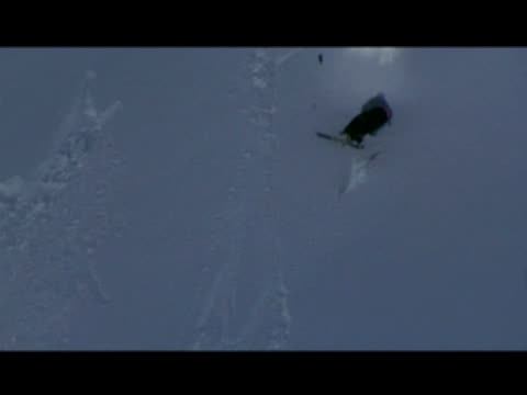 october 31, 2006 montage professional snow skiers crash landing from miscalculated rotation jumps - letterbox format stock videos & royalty-free footage