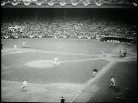 october 6, 1936 montage joe dimaggio hits single that scores the winning run of 1936 world series / polo grounds, new york city, new york, united... - fielder stock videos & royalty-free footage