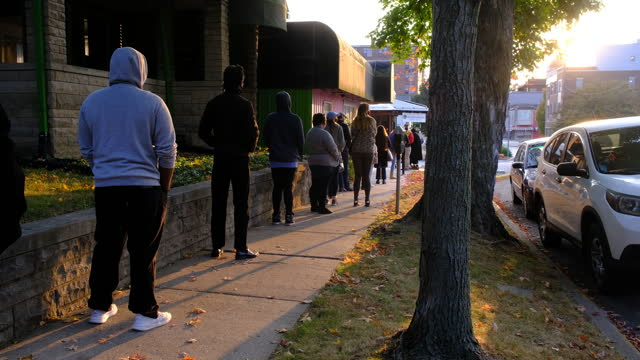 october 6, 2020; bloomington, indiana: over 100 voters are lined up outside election central during the first day of early voting in monroe county,... - election stock videos & royalty-free footage