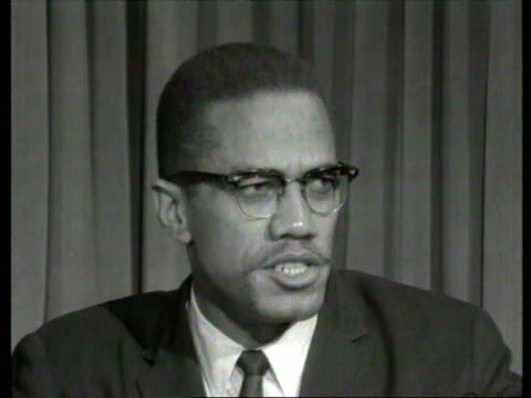 october 7, 1964 malcolm x speaking in interview about allegations that he is on the lunatic fringe of the american negro movement./ london, england/... - アメリカ黒人の歴史点の映像素材/bロール