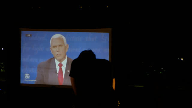 october 7, 2020; bloomington, indiana: a student is silhouetted watching democratic vice presidential candidate kamala harris and republican vice... - debatte stock-videos und b-roll-filmmaterial