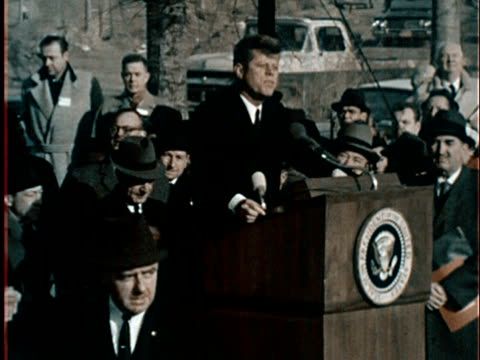 october 9 1962 ws spectators and flags/ ms president john f kennedy delivering speech at groundbreaking ceremony for 1964 world's fair in flushing... - flushing meadows corona park stock videos and b-roll footage