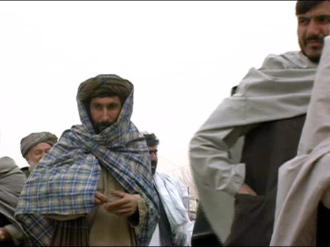 October 9 2004 Men moving through line outside polling station to vote in presidential election / Kandahar Afghanistan / AUDIO