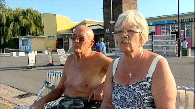 gravesend groups of people sunbathing in october heatwave vox pops sunbathers bognor regis participants in bognor's birdman competition jumping into... - media interview stock videos and b-roll footage