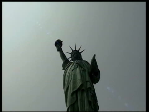 october; in 1886 the statue of liberty was opened to the public lib usa: new york: new york: ext statue of liberty / woman wearing statue of liberty... - headband stock videos & royalty-free footage