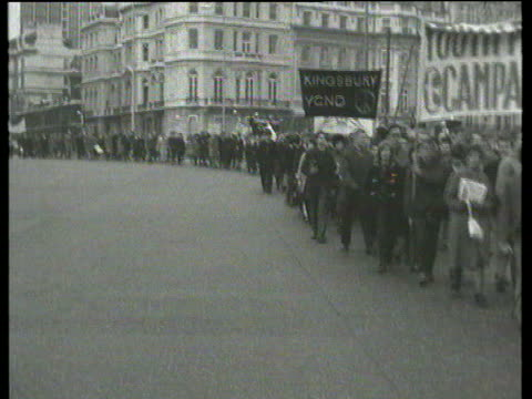 october in 1962 thousands marched against the handling of the cuban missile crisis lib london ext marchers along / police carrying away sit down... - 1962 stock videos and b-roll footage