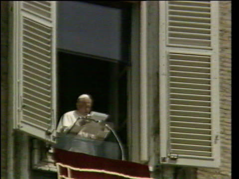 october; in 1978 a polish bishop became pope john paul ii lib vatican: st peters square: ext pope john paul ii addressing crowd from balcony int pope... - pope john paul ii stock videos & royalty-free footage