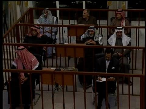 vídeos y material grabado en eventos de stock de october in 2005 saddam hussein went on trial for war crimes baghdad int former iraqi president saddam hussein in court faces war crime charges - saddam hussein
