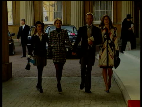 october; lib england: london: buckingham palace: ext sting along with wife trudi styler and daughters to receive cbe - trudie styler stock videos & royalty-free footage