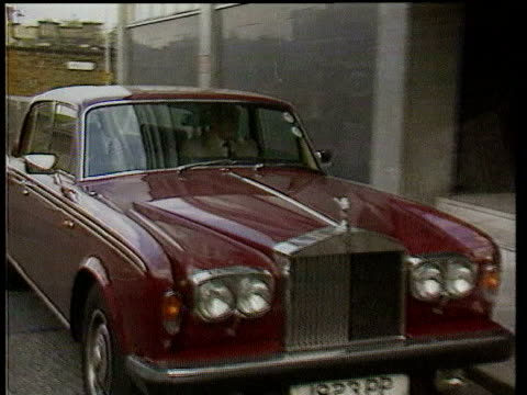 october lib highly decorated rolls royce of john lennon along road / rolls royce of robert maxwell stopping and maxwell getting out int sir colin... - robert maxwell stock videos and b-roll footage