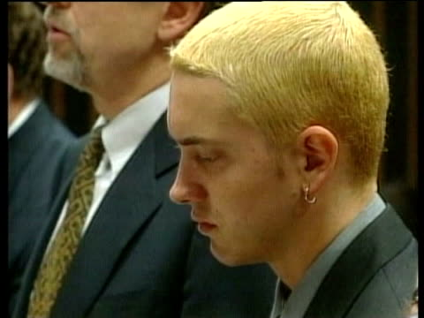 october; lib michigan: pontiac: int eminem in court charged with possession of an concealed illegal weapon - ポンティアック点の映像素材/bロール