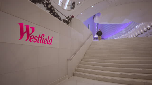 oculus world trade center transportation hub in manhattan new york. westfield neon sign in foreground. establishing shot. filmed during the... - beauty stock videos & royalty-free footage