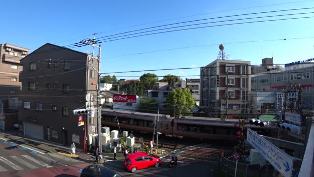 Odakyu Train Crossing near Yomiuri Land Mae Station, Tokyo Japan