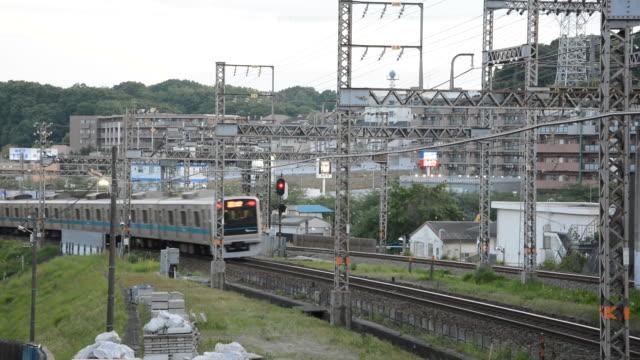 odakyu train crossing residential district of yurigaoka, tokyo japan - 列車点の映像素材/bロール