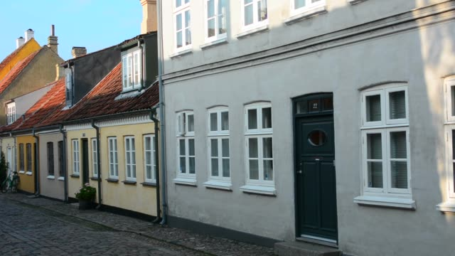 odense beautiful old row homes cobblestone streets in hans christian andersen birthplace home - residential district stock videos & royalty-free footage