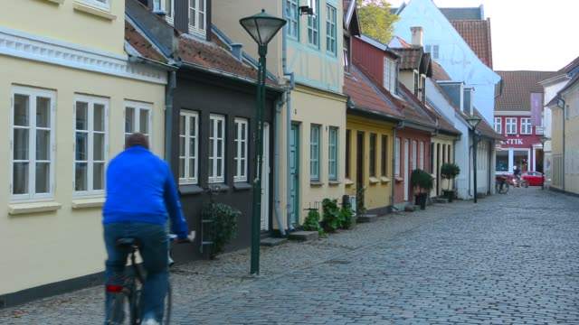 odense beautiful old row homes cobblestone streets in hans christian andersen birthplace home - row house stock videos and b-roll footage