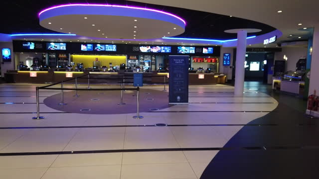 odeon cinema, in milton keynes, prepares to reopen after coronavirus lockdown, shows screen, ticket machine and popcorn - food and drink stock videos & royalty-free footage