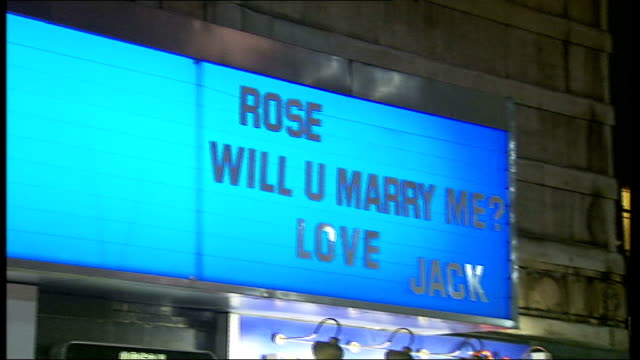 odeon cinema offers personal message space england london cinema billboard advertising films pan to proposal of marriage on board worker putting up... - odeon cinemas stock videos & royalty-free footage