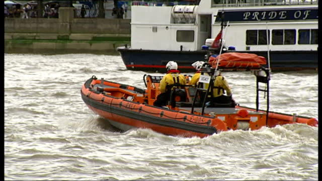 odette penwarden interview sot rnli lifeboat and crew along thames crew onboard lifeboat as along peter bradley interview sot pleasure boats along... - marchioness stock videos and b-roll footage